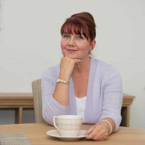 Steph McCann Health Coach with cup of tea