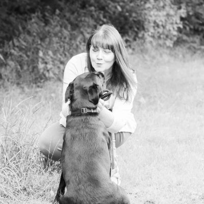 Steph McCann with black labrador